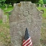 Sharp Hill stone with flag